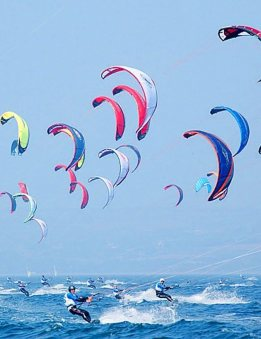 kite surfers riding waves in the mediterranean