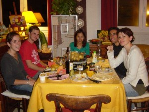 french language students enjoying dinner at their home-stay accommodation