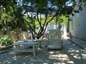 A shady terrace in the mediterranean on a sunny day
