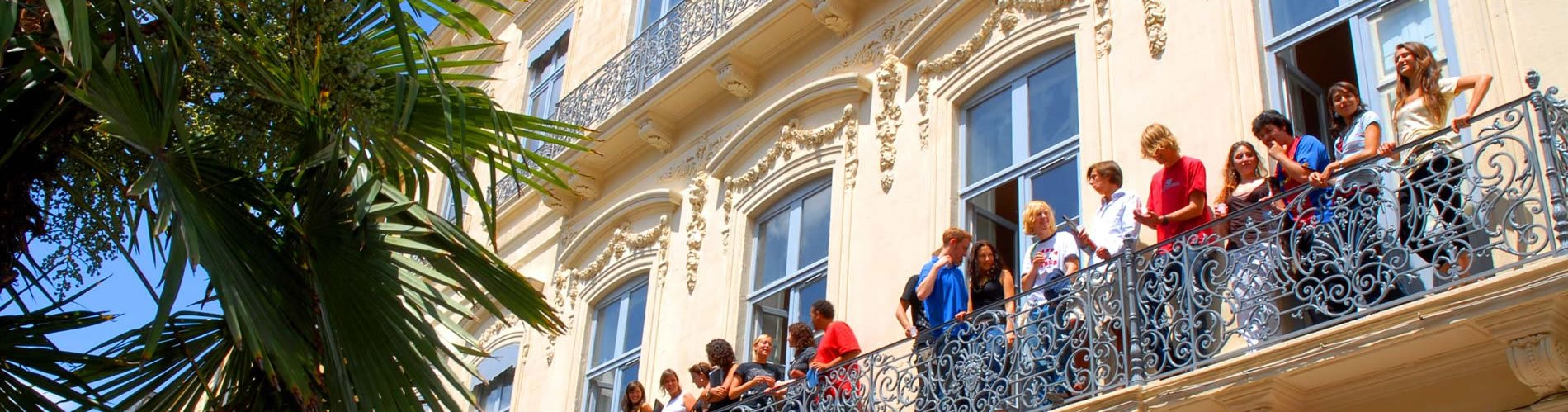 French language students on a balcony in Montpellier taking in the sunshine