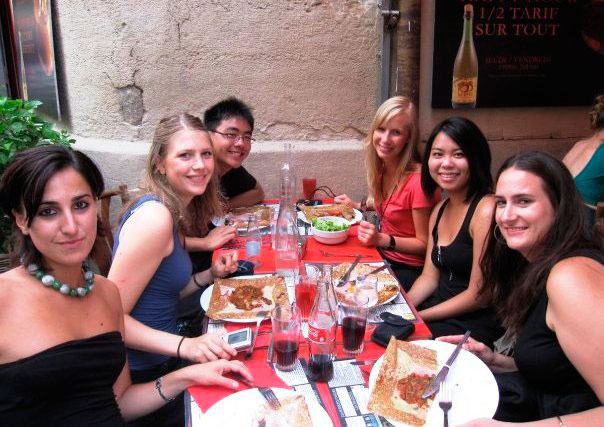 A group of young people eating outside a restaurant in the south of France