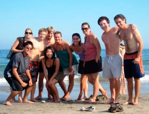Students having fun on the beach on a hot summer day in the Mediterranean